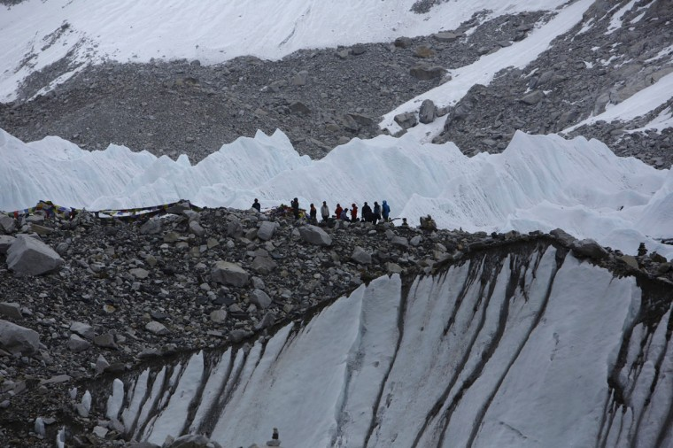 Trekkers stand in Everest Base camp, approximately 5,300 meters above sea level, in the Solukhumbu District on May 6, 2014. (REUTERS/Navesh Chitrakar)