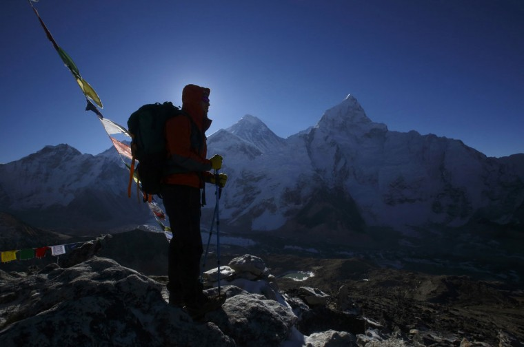 A trekker stands in front of Mount Everest, which is 8,850 meters high, at Kala Patthar in Solukhumbu District on May 7, 2014. (REUTERS/Navesh Chitrakar)