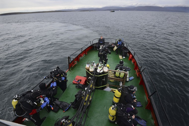 Divers prepare to dive on the wreck of a German WWI warship at Scapa Flow, Orkney Islands, Scotland on May 5, 2014. (REUTERS/Nigel Roddis)