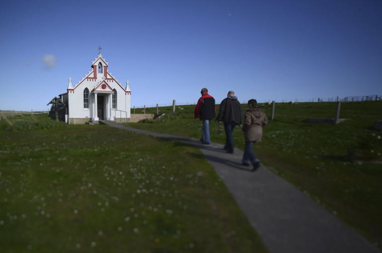 The Italian chapel is seen on the Orkney Islands, Scotland on May 8, 2014. During WWII, Italian prisoners of war were used to build what is know as the Churchill barriers, four stone causeways that link some the islands. An Italian prisoner Domenico Chiocchetti, built what is known as the Italian chapel from one of the huts at the prisoner of war camp. (REUTERS/Nigel Roddis)