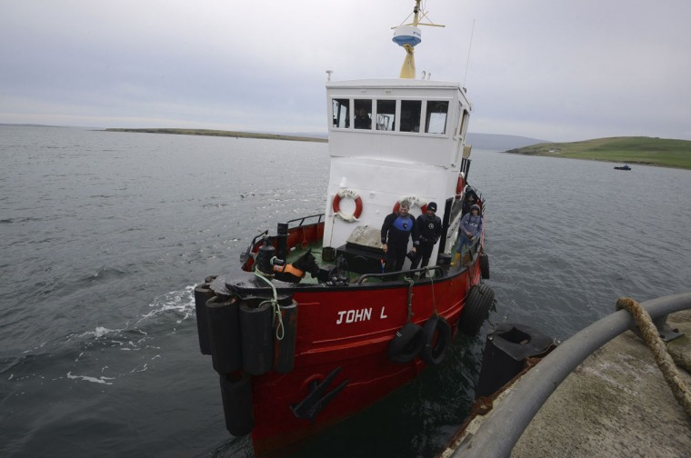 A dive boat moors up on the island of Hoy in Orkney, Scotland on May 6, 2014. (REUTERS/Nigel Roddis)