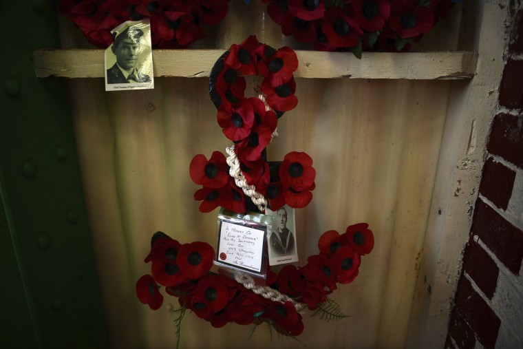 A poppy memorial for Leading Seaman Elias Dymock, who died on HMS Vanguard, is seen on display at the Lyness museum on the island of Hoy in the Orkney Islands, Scotland on May 6, 2014. On July 9, 1917, an accidental explosion destroyed HMS Vanguard, killing over 800 men. (REUTERS/Nigel Roddis)