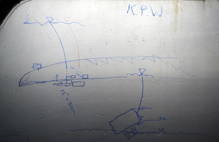 A dive plan of SMS Kronprinz Wilhelm, a German WWI warship, is drawn on the window of a dive boat at Scapa Flow in the Orkney Islands, Scotland on May 6, 2014. (REUTERS/Nigel Roddis)