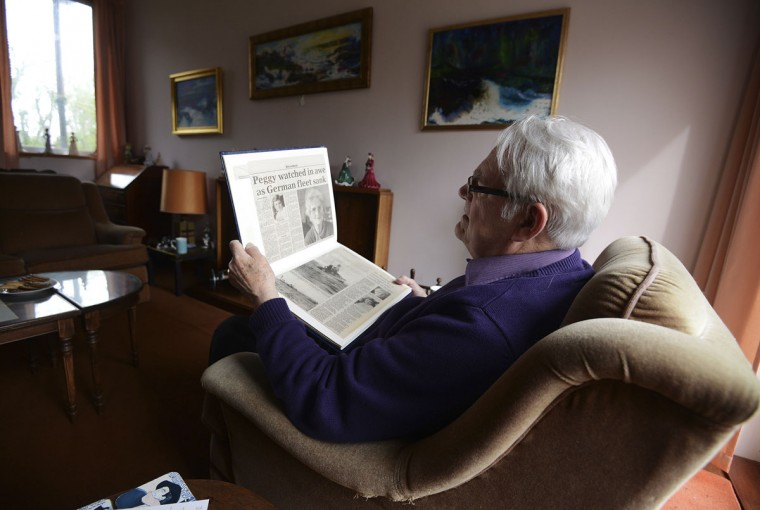 Gary Gibson whose mother, Peggy, witnessed the Grand Scuttle, sits at home in the Orkney Islands, Scotland on May 5, 2014. Peggy and her sisters witnessed the Grand Scuttle in 1919 while they were on a school trip. (REUTERS/Nigel Roddis)