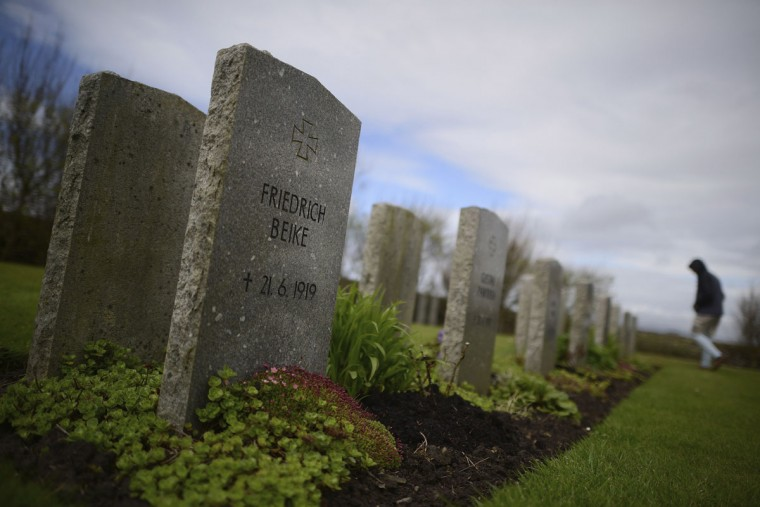 The graves of 13 German sailors who died in the Grand Scuttle stand in Lyness Naval cemetery on the Orkney Islands, Scotland on May 6, 2014. (REUTERS/Nigel Roddis)