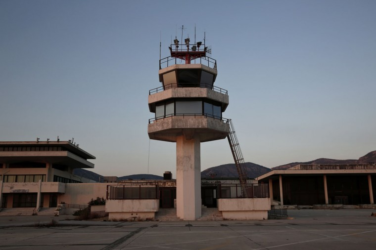 An auxiliary control tower stands in front of the east terminal of the former Athens International airport, Hellenikon. (REUTERS/Yorgos Karahalis)