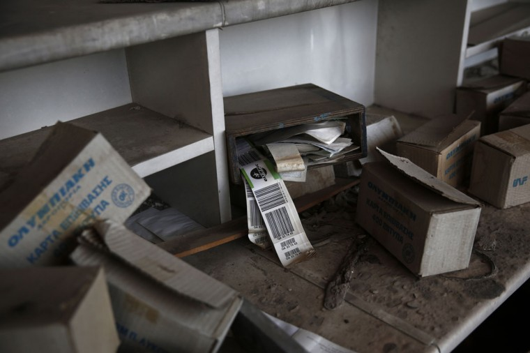Olympic Airways travel tags are seen behind a desk inside the west terminal of the former Athens International airport, Hellenikon. (REUTERS/Yorgos Karahalis)