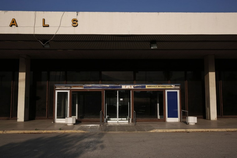An entrance to the arrivals area is seen at the east terminal of the former Athens International airport, Hellenikon. (REUTERS/Yorgos Karahalis)