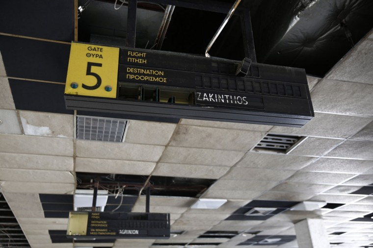 An announcement board is seen inside a deserted hall at the west terminal of the former Athens International airport, Hellenikon. (REUTERS/Yorgos Karahalis)