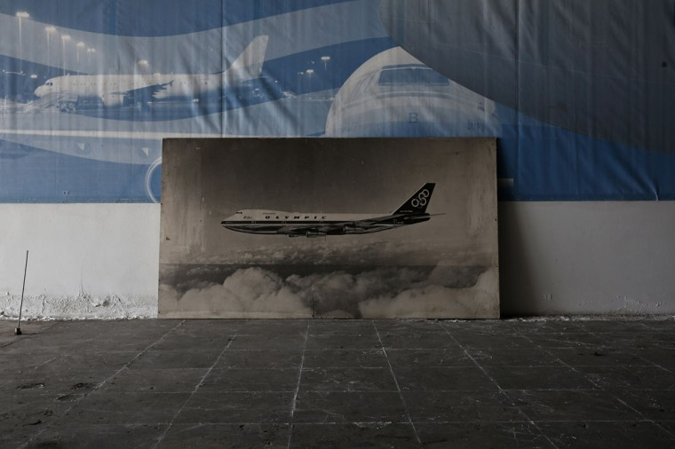 A photograph of an Olympic Airways aircraft is seen inside a hall which was used as a museum for the carrier, after the closure of the Hellenikon airport south of Athens. (REUTERS/Yorgos Karahalis)