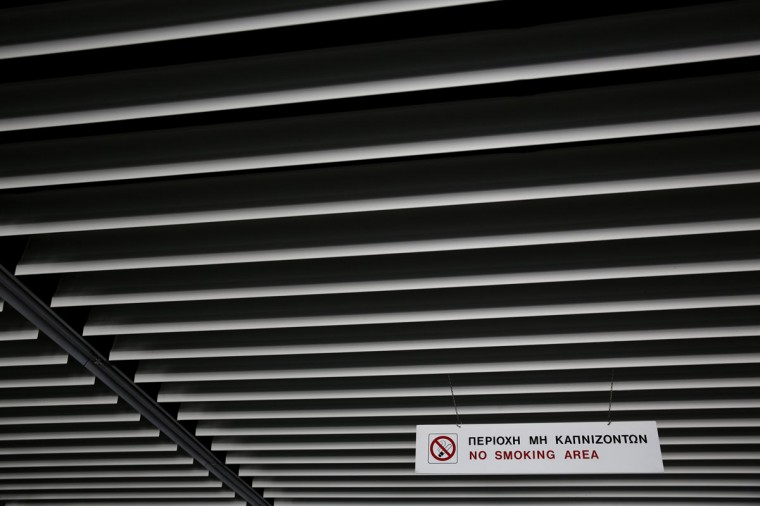 "A ""no-smoking"" sign is seen inside a deserted hall at the east terminal of the former Athens International airport, Hellenikon on June 16, 2014. (REUTERS/Yorgos Karahalis)"