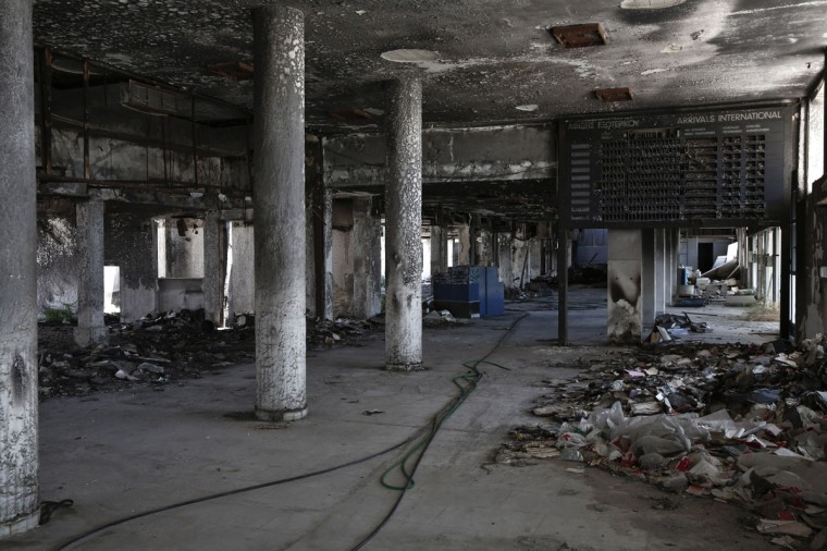 A burnt out arrivals hall is seen at the west terminal of the former Athens International airport, Hellenikon. (REUTERS/Yorgos Karahalis)
