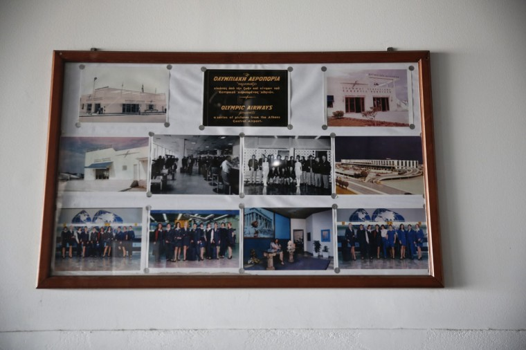 Photographs from the former Athens airport, Hellenikon, are seen inside a hall where a museum for Olympic Airways was set up, after the closure of the Hellenikon airport south of Athens June 16, 2014. (REUTERS/Yorgos Karahalis)