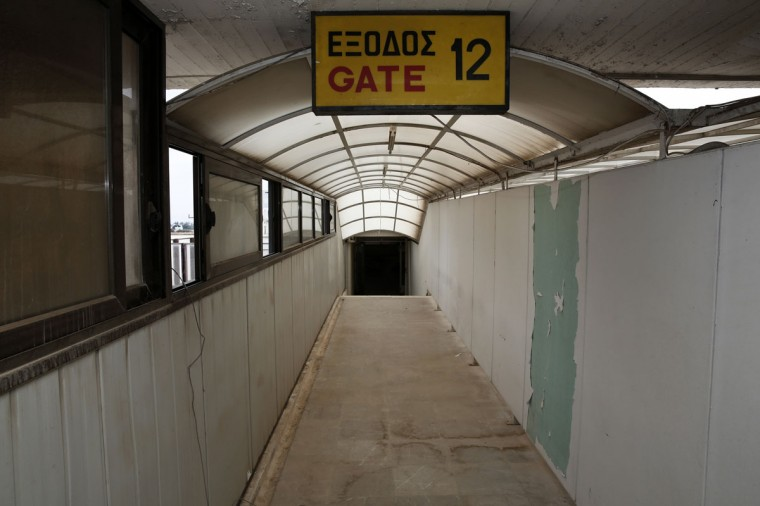 A corridor leading to a passenger gate is seen in the east terminal of the former Athens International airport, Hellenikon. (REUTERS/Yorgos Karahalis)