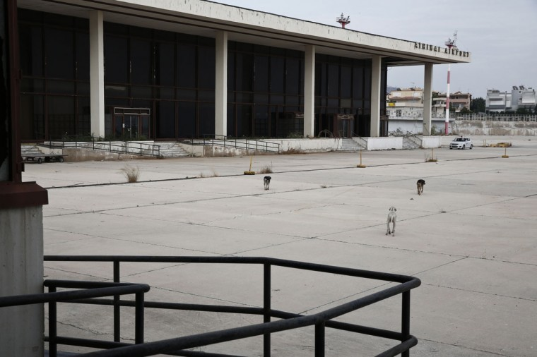 Stray dogs walk outside the former Athens International airport, Hellenikon. (REUTERS/Yorgos Karahalis)