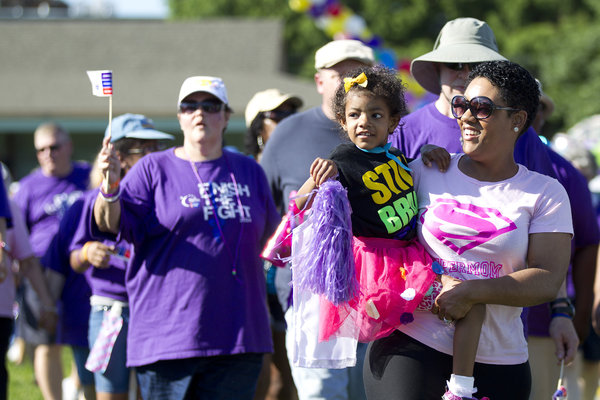 Brandi Garrett, right, of Woodbridge, Va., holds her 5-year-old daughter, Madison Garrett, during the survivors' lap at the Relay for Life in Laurel on June 7. Brandi grew up in Laurel and is an alumni of Laurel High School Class of 1999. Her daughter Madison is a survivor of stage 4 high risk neuroblastoma. (Jen Rynda, Baltimore Sun Media Group)