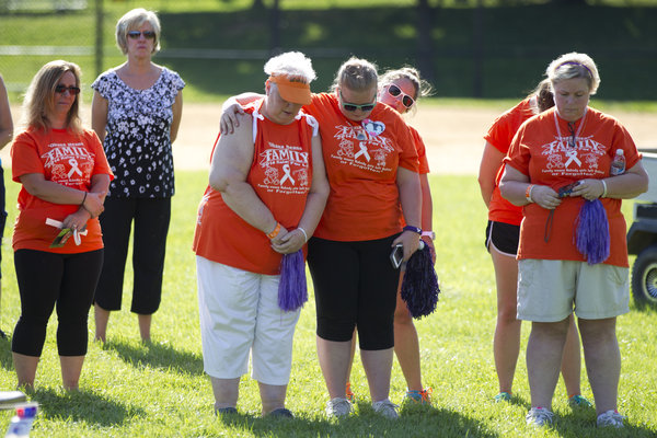 Walkers bow their heads and pray at the Laurel Relay for Life on June 7. (Jen Rynda, Baltimore Sun Media Group)