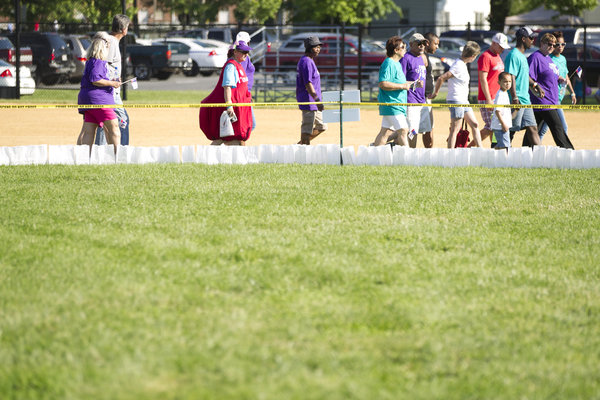 Cancer survivors walk during the survivors' lap at the Laurel Relay for Life on June 7. (Jen Rynda, Baltimore Sun Media Group)