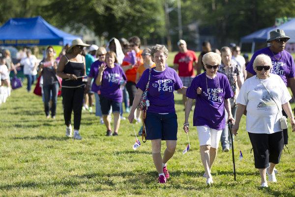 Cancer survivor Lori Stewart, left, of West Laurel, walks with her mother, cancer survivor Jane Stewart, center, of West Laurel, and aunt Liz Wise, right, of Phenix City, Al. (Jen Rynda, Baltimore Sun Media Group)