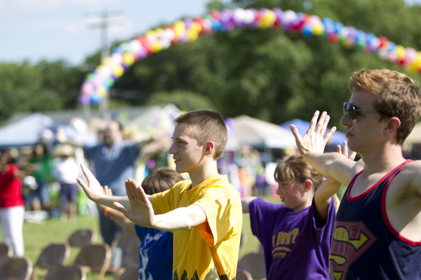 Walkers stretch before the start of the Laurel Relay for Life. (Jen Rynda, Baltimore Sun Media Group)