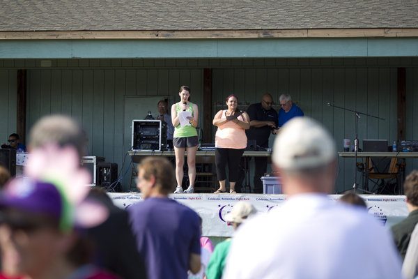 Mandi Philips, left, and Kristy Murray speak to the crowd at the Relay for Life walk in Laurel on June 7. (Jen Rynda, Baltimore Sun Media Group)