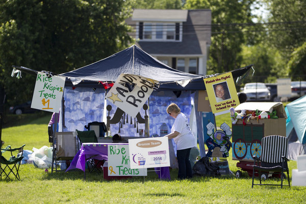Team members set up tents for their teams during the Relay for Life in Laurel on June 7. (Jen Rynda, Baltimore Sun Media Group)