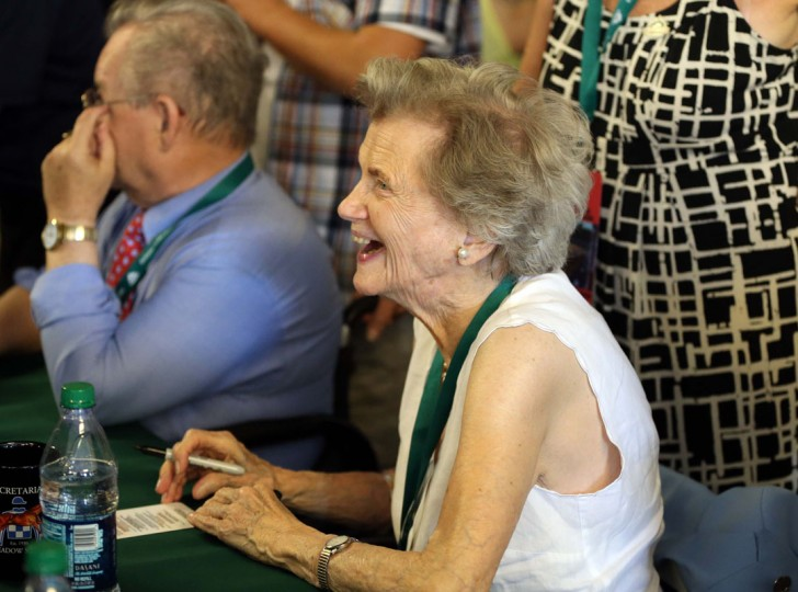 Penny Chenery, owner of Secretariat signs autographs before the 2014 Belmont Stakes at Belmont Park. (Brian Spurlock-USA TODAY Sports)