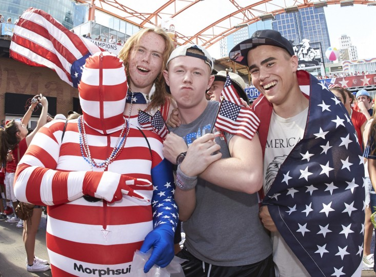 Fans prepare for the World Cup match between United States and Ghana at the Power and Light District in Kansas City. (Gary Rohman/USA TODAY Sports photo)