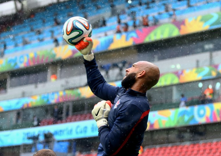 USA goalkeeper Tim Howard warms up in the rain prior to the game against Germany during the 2014 World Cup at Arena Pernambuco. (Mark J. Rebilas-USA TODAY Sports)