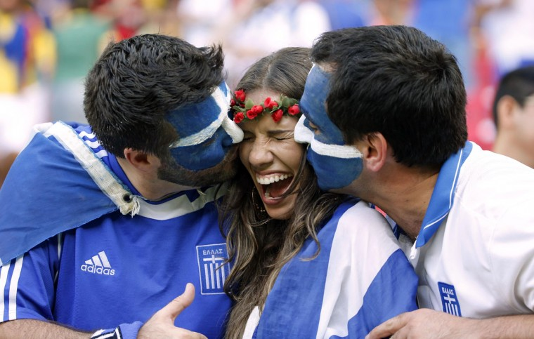 A Greece fan is kissed prior to the World Cup game between Costa Rica and Greece at Arena Pernambuco. (Winslow Townson/USA Today Sports)