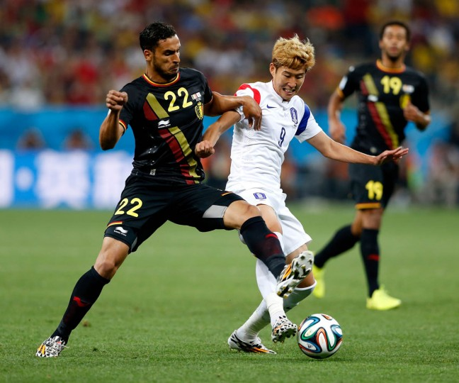 Nacer Chadli of Belgium and Son Heung-Min of South Korea compete for the ball during the 2014 FIFA World Cup Brazil Group H match between South Korea and Belgium at Arena de Sao Paulo on June 26, 2014 in Sao Paulo, Brazil. (Alexandre Schneider/Getty Images)