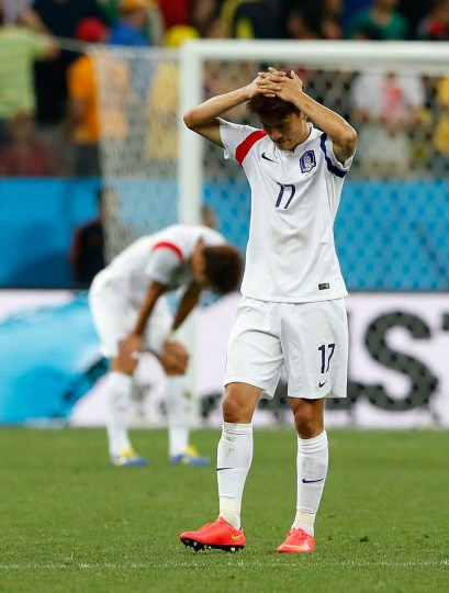 Lee Chung-Yong of South Korea reacts after the 2014 FIFA World Cup Brazil Group H match between South Korea and Belgium at Arena de Sao Paulo on June 26, 2014 in Sao Paulo, Brazil. (Alexandre Schneider/Getty Images)