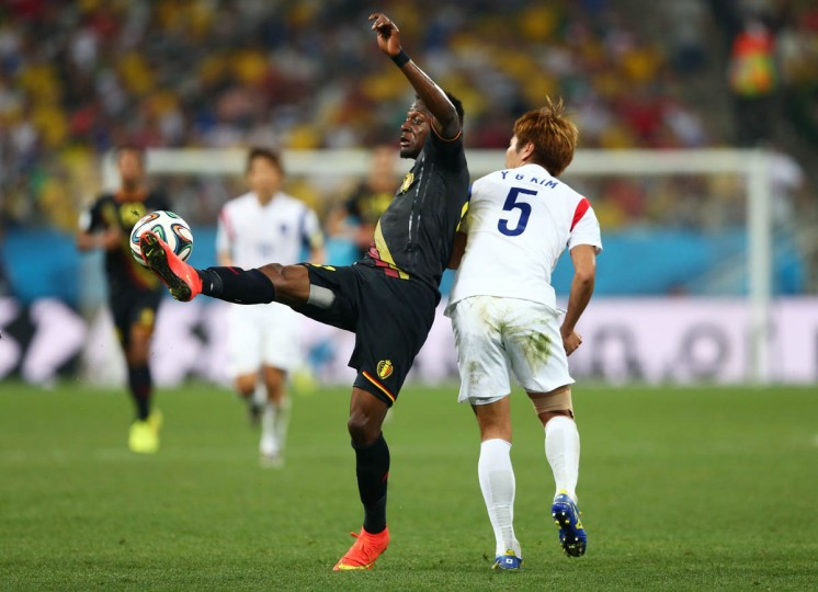 Divock Origi of Belgium and Kim Young-Gwon of South Korea compete for the ball during the 2014 FIFA World Cup Brazil Group H match between South Korea and Belgium at Arena de Sao Paulo on June 26, 2014 in Sao Paulo, Brazil. (Clive Brunskill/Getty Images)