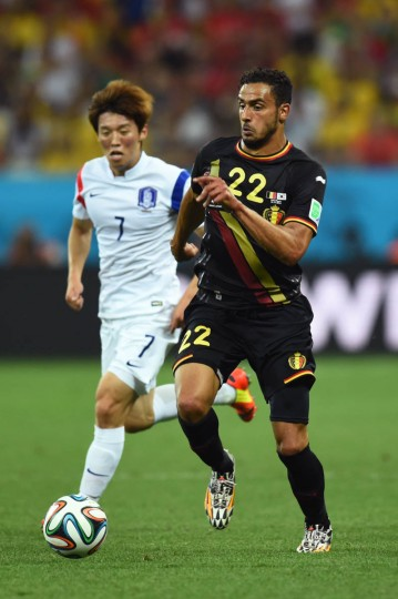 Nacer Chadli of Belgium and Kim Bo-Kyung of South Korea compete for the ball during the 2014 FIFA World Cup Brazil Group H match between South Korea and Belgium at Arena de Sao Paulo on June 26, 2014 in Sao Paulo, Brazil. (Stu Forster/Getty Images)
