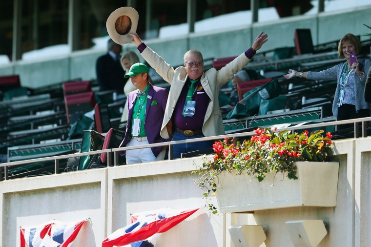 Steve Coburn, co-owner of California Chrome waves to fans at Belmont Park on June 7, 2014 in Elmont, New York. California Chrome will be attempting to win the triple crown in the Belmont Stakes. (Photo by Mike Ehrmann/Getty Images)