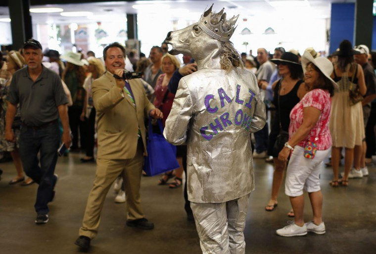 Mike Calimano is pictured wearing a California Chrome outfit in the stadium before the 146th running of the Belmont Stakes in Elmont, New York June 7, 2014. REUTERS/Mike Segar