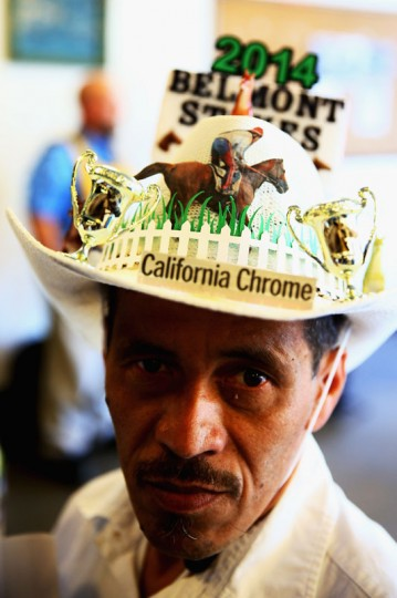A fan wears a hat prior to the Belmont Stakes at Belmont Park on June 7, 2014 in Elmont, New York. (Photo by Streeter Lecka/Getty Images)