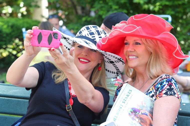 Nicole Slavek (left) and Barb Traxler (right) both fro Minnesota take their own photograph before the 2014 Belmont Stakes at Belmont Park. (Brad Penner-USA TODAY Sports)