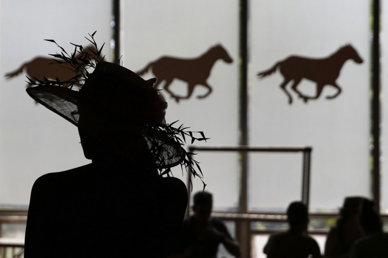 A woman is seen in silhouette at Belmont Park before the 2014 Belmont Stakes in Elmont, New York June 7, 2014. (REUTERS/Shannon Stapleton)