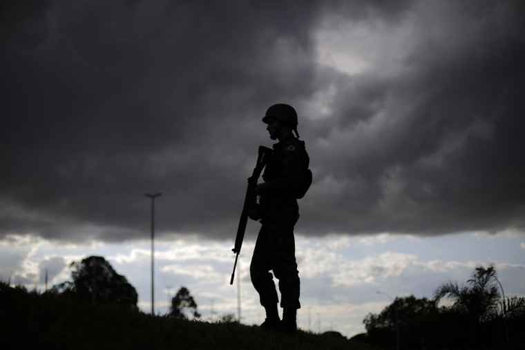 A Brazilian army soldier stands during a security plan drill for the upcoming World Cup soccer tournament along the streets of Brasilia on June 5, 2014. (REUTERS/Ueslei Marcelino)