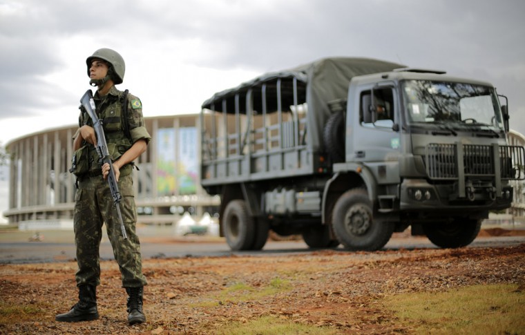 A Brazilian army soldier stands during a security plan drill for the upcoming World Cup soccer tournament in front of Mane Garrincha National Stadium in Brasilia on June 5, 2014. (REUTERS/Ueslei Marcelino)