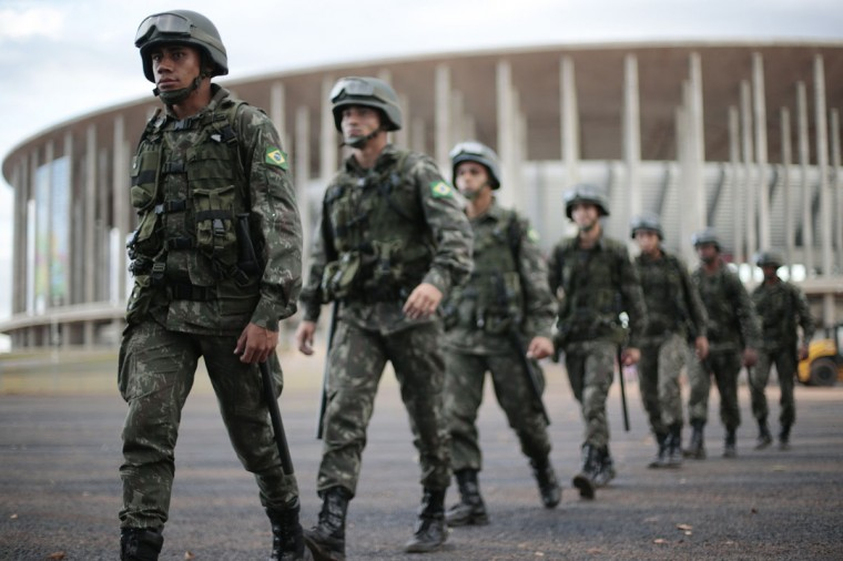 Brazilian army soldiers work during a security plan drill for the upcoming World Cup soccer tournament in front of Mane Garrincha National Stadium in Brasilia on June 5, 2014. (REUTERS/Ueslei Marcelino)