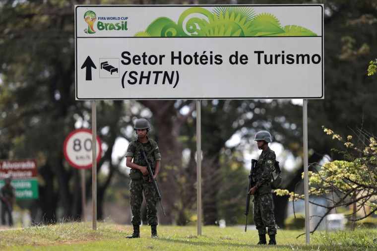 Brazilian army soldiers stand during a security plan drill for the upcoming World Cup soccer tournament along the streets of Brasilia on June 5, 2014. (REUTERS/Ueslei Marcelino)