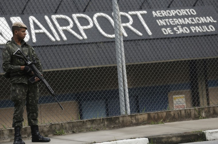 A Brazilian army soldier stands guard at Guarulhos airport, ahead of the 2014 World Cup, in Sao Paulo on June 7, 2014. (REUTERS/Nacho Doce)