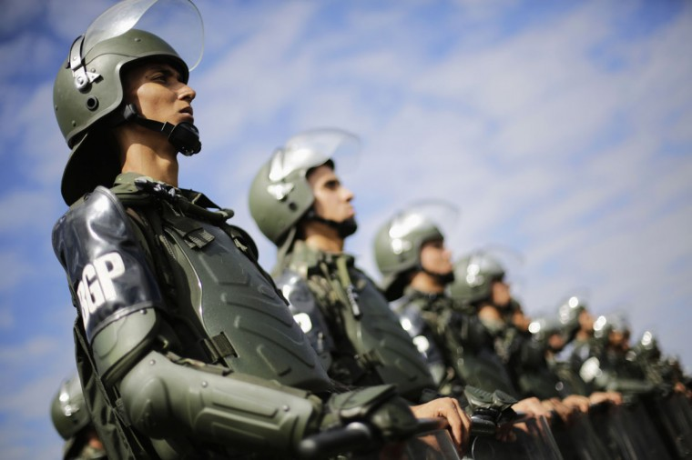 Members of the Brazilian Army, Navy and Air Force stand at attention during a presentation of Defense and Security personnel and equipment that will be used during the 2014 World Cup in Brasilia on June 8, 2014. (REUTERS/Ueslei Marcelino)