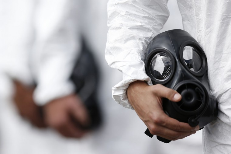 A soldier holds a gas mask during an event by members of the Brazilian Army, Navy and Air Force presenting Defense and Security personnel and equipment that will be used during the 2014 World Cup in Brasilia, on June 8, 2014. (REUTERS/Ueslei Marcelino)