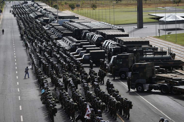 Members of the Brazilian Army, Navy and Air Force attend a presentation of Defense and Security personnel and equipment that will be used during the 2014 World Cup in Brasilia, on June 8, 2014. (REUTERS/Ueslei Marcelino)