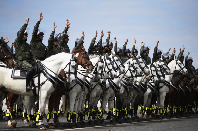 Members of the Brazilian Army, Navy and Air Force riding horses attend a presentation of Defense and Security personnel and equipment that will be used during the 2014 World Cup in Brasilia, on June 8, 2014. (REUTERS/Ueslei Marcelino)