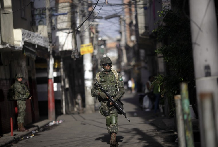 A Brazilian Army soldier patrols the Mare slums complex in Rio de Janeiro, on April 5, 2014. (REUTERS/Ricardo Moraes)