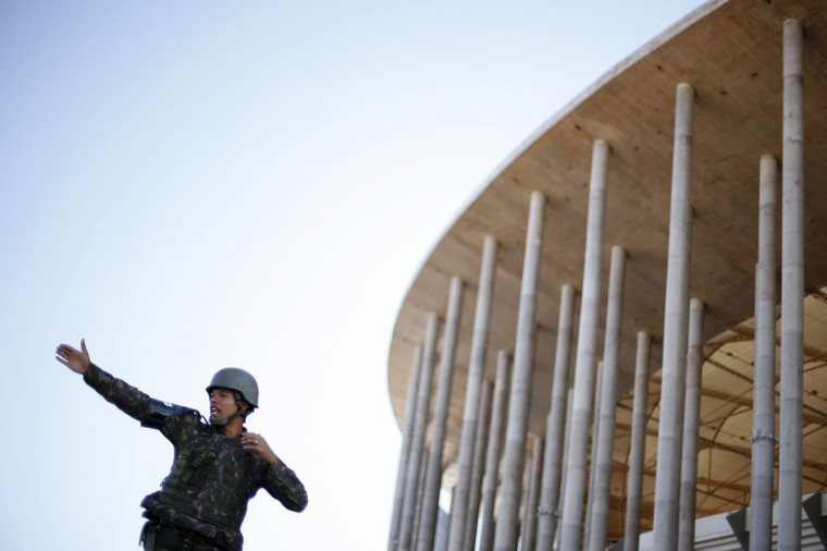 A member of the Brazilian army directs traffic during a simulated chemical and radiological attack exercise at the Mane Garrincha National Stadium in Brasilia on June 9, 2014. (REUTERS/Ueslei Marcelino)